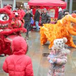 Lion dancers teasing kids at Lancaster Chinese New Year Carnival 2016 | Hua Xian Chinese Society